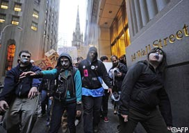 """Occupy Wall Street"" demonstrators stage a march dressed as corporate zombies during a protest near Wall Street in New York,"